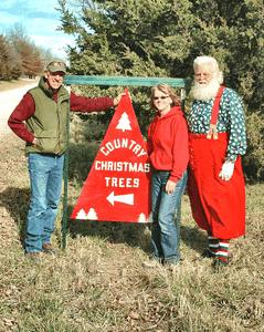 Santa and Owners of Country Christmas Trees